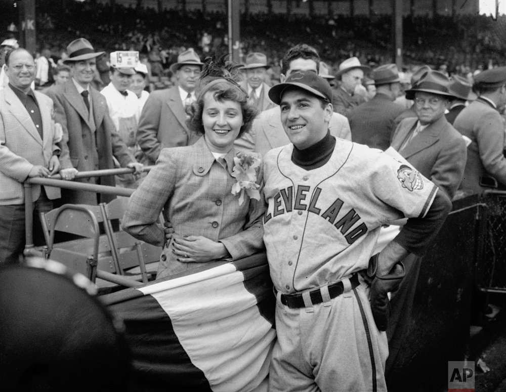 Lou Boudreau and his wife are shown in Boston during the first game of the World Series against the Braves on October 6, 1948. (AP Photo)