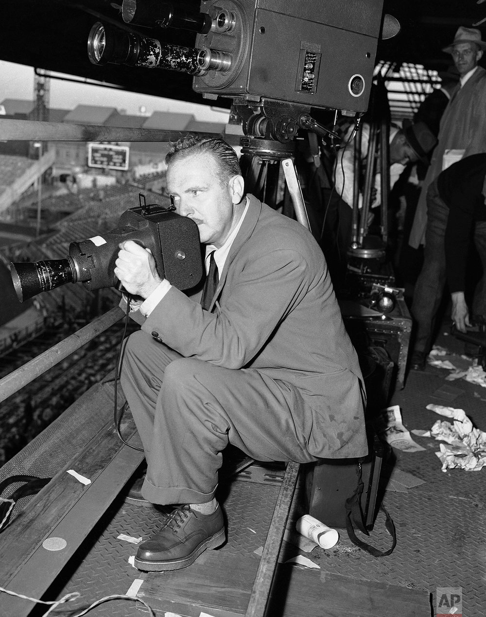 John Lindsay, New York Associated Press photographer, operates the K-25 camera during the second World Series game at Boston, Mass., Oct. 7, 1948. (AP Photo)