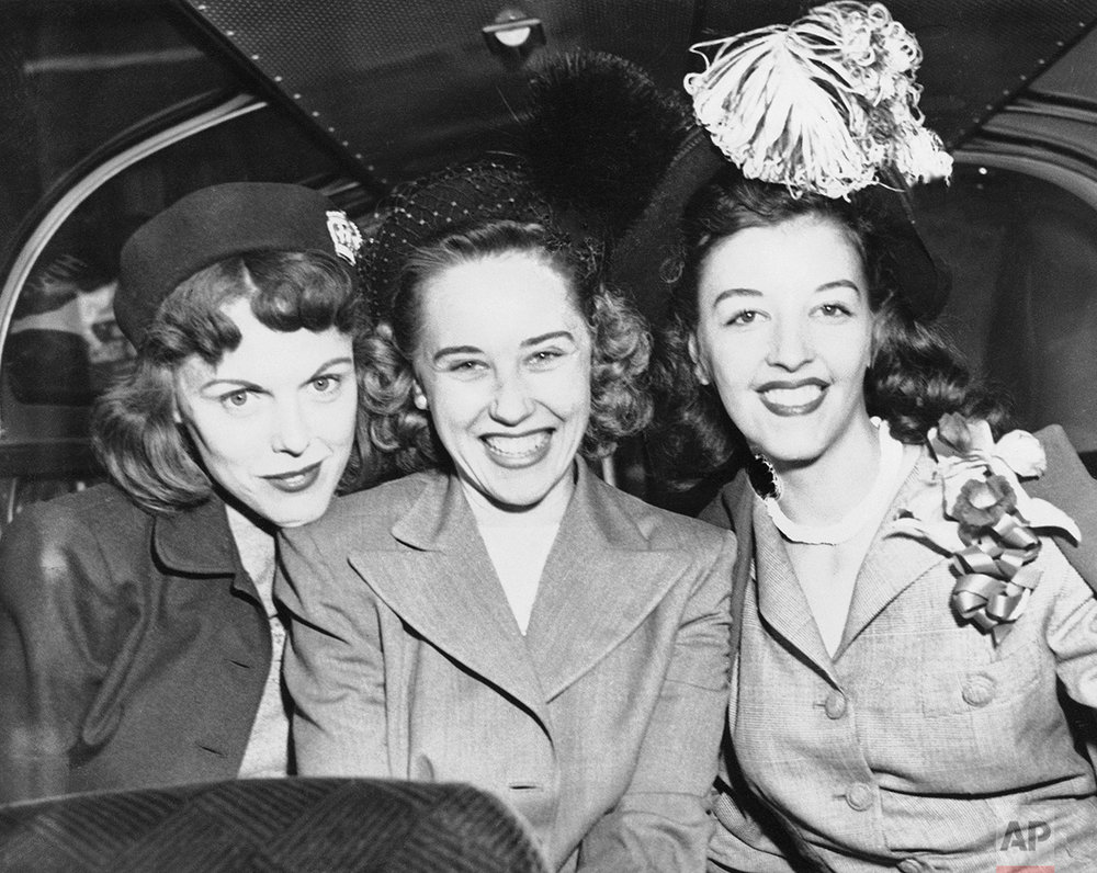 This trio of wives of Cleveland Indian pitchers show their reaction to the Indians 4-1 victory over the Braves in the second series game on Oct. 7, 1948, in Boston as they prepare to depart for Cleveland. From Left to right are Mrs. Robert Feller, whose husband pitched the series opener, Mrs. Robert Lemon, wife of Bob Lemon who hurled and Mrs. Gene Bearden whose husband is expected to take mound in third game tomorrow in Cleveland. (AP Photo)