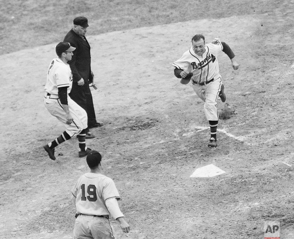 Relief pitcher Gene Bearden runs off the infield at Braves Field, Oct. 11, 1948, in Boston, Massachusetts, after the Cleveland Indians defeated the Boston Braves, 4-3, to take the 1948 World Series by a games score of 4-2. (AP Photo)