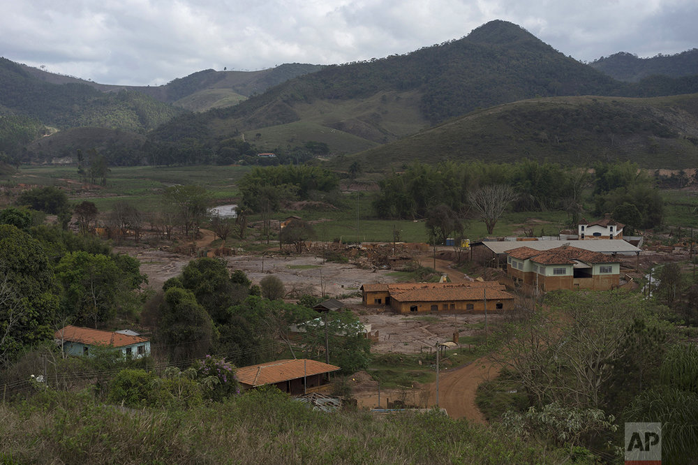 This Oct. 13, 2016 photo shows a view of the hamlet Paracatu, Brazil, destroyed by a mudslide triggered in Nov. 2015, by the failing of a dam at a nearby iron mine. On the other side of the lush mountains miles north of Rio de Janeiro, lies a valley so rich it's believed to hold one of the largest iron deposits in the planet. (AP Photo/Leo Correa)