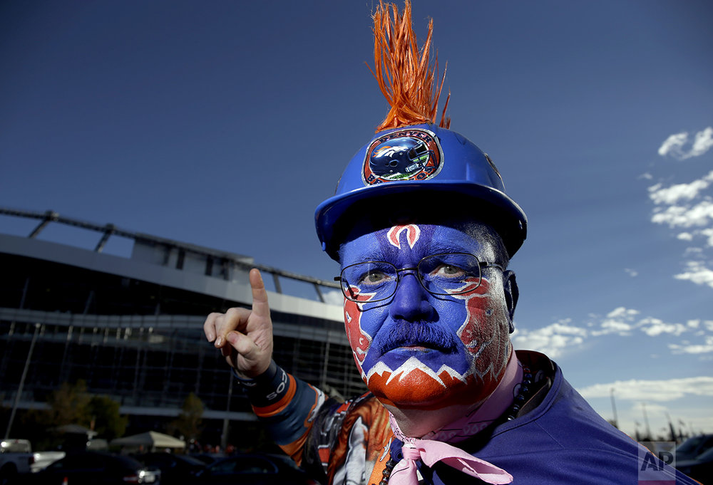 Denver Broncos fan Richard Finley poses for a photo outside Mile High Stadium prior to an NFL football game against the Houston Texans, Monday, Oct. 24, 2016, in Denver. (AP Photo/Jack Dempsey)
