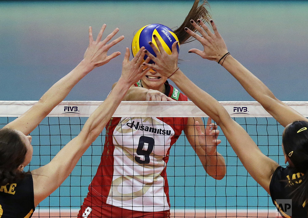 VafikBank Istanbul team players Lonneke Sloetjes, from Netherlands, left, and Milena Rasic, from Serbia, block the shot of Hisamitsu Springs Kobe team player Maja Tokarska, from Poland, during the FIVB Women's Club World Championship 2016 in Pasay, south of Manila, Philippines on Tuesday, Oct. 18, 2016. VafikBank Istanbul team won the match 3-1. (AP Photo/Aaron Favila)