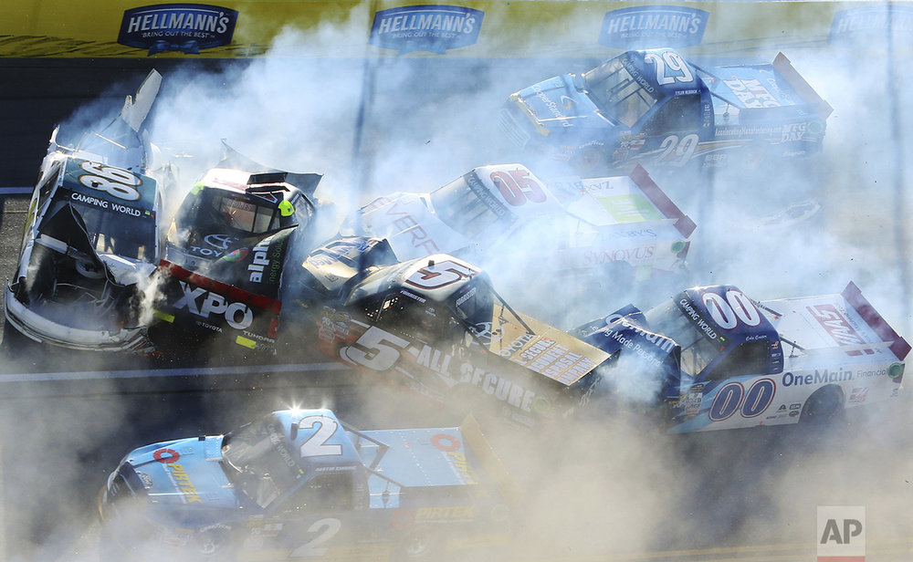 Brandon Brown (86), Ben Rhodes (41), Korbin Forrister (5), John Wes Townley (05), Tyler Reddick (29), Cole Custer (00) and Austin Cindric (2) are involved in a wreck during the NASCAR Camping World Truck Series race at Talladega Superspeedwa, Saturday, Oct. 22, 2016, in Talladega, Ala. (AP Photo/Jay Alley)