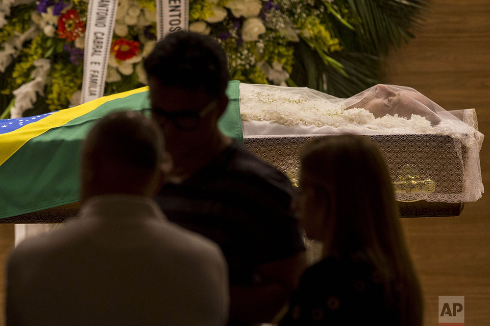 The body of Carlos Alberto Torres, former football player and captain of Brazil during the 1970 World Cup, lies in state at the Brazilian Football Confederation headquarters in Barra da Tijuca, in Rio de Janeiro, Brazil, Tuesday, Oct. 25, 2016. (AP Photo/Mauro Pimentel)
