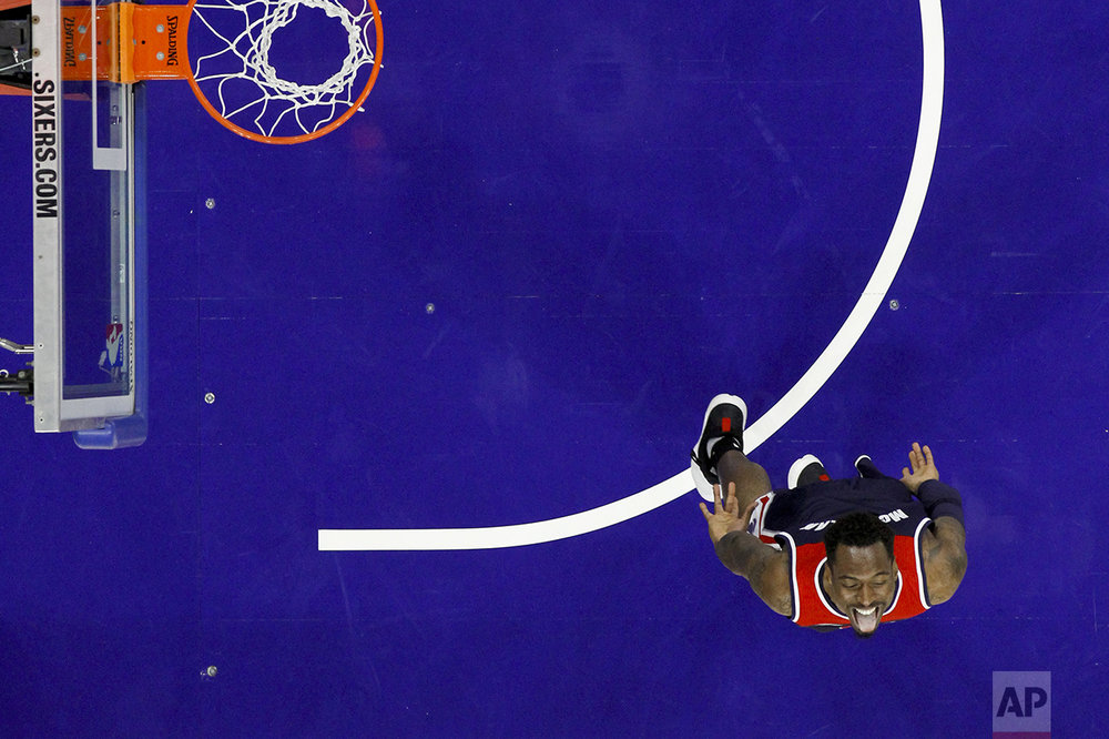 Washington Wizards' Sheldon McClellan reacts after scoring during the second half of a preseason NBA basketball game against the Philadelphia 76ers, Thursday, Oct. 6, 2016, in Philadelphia. (AP Photo/Matt Slocum)