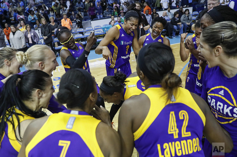 Los Angeles Sparks forward Candace Parker, back center, celebrates with teammates a 95-75 win over the Chicago Sky after Game 4 of the WNBA basketball semifinals, Tuesday, Oct. 4, 2016, in Rosemont, Ill. (AP Photo/Kamil Krzaczynski)