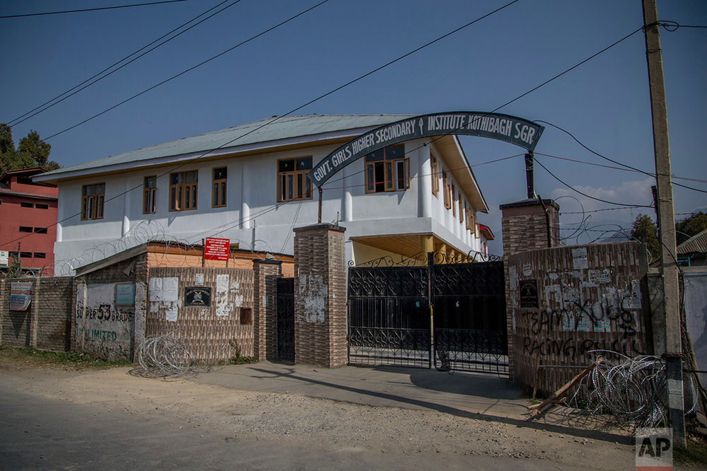 In this Friday, Oct. 21, 2016 photo, barbwire surrounds the Government Girls Higher Secondary Institute after it was converted into a paramilitary bunker in Srinagar, Indian controlled Kashmir. Kashmir has been under a tight security lockdown, along with a separatist-sponsored strike, as Indian forces struggle to quell the uprising and arrest thousands of civilian protesters. The region, also claimed by Pakistan, is divided between the two nuclear-armed neighbors by a heavily militarized Line of Control. (AP Photo/Dar Yasin)