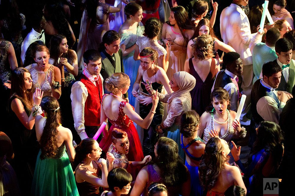 Hannah Shraim, 17, center, dances with a group of her friends during their senior prom for Northwest High School, Friday, May 13, 2016, in Silver Spring, Md., at the Fillmore Theater. (AP Photo/Jacquelyn Martin)