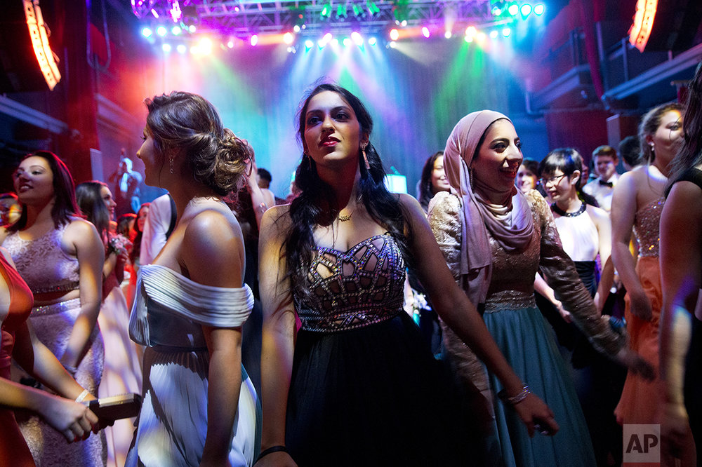 Hannah Shraim, right, dances next to Jahnavi Muralidarin during Northwest High School's senior prom held at the Fillmore Theater in Silver Spring, Md., on Friday, May 13, 2016. (AP Photo/Jacquelyn Martin)
