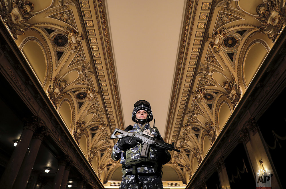 A member of the Romanian armed forces models a future Romanian military combat uniform at the Central Army House in Bucharest, Romania, Tuesday, Oct. 25, 2016, as the country celebrates Army Day marking its liberation from Nazi occupation in 1944. (AP Photo/Vadim Ghirda)