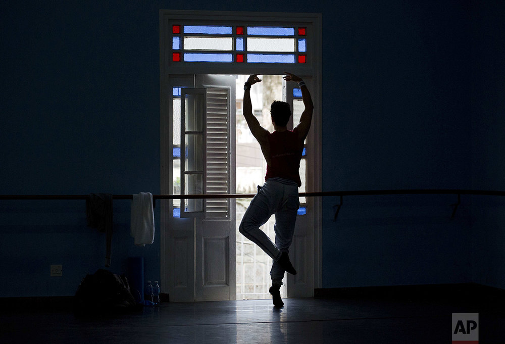 A ballet dancer performs during a class at the National Ballet of Cuba headquarters in Havana, Cuba, Friday, Oct. 28, 2016. The International Ballet Festival of Havana, held every two years, will take place Oct. 28 - Nov. 6, with 20 performances and several world premieres. (AP Photo/Ramon Espinosa)
