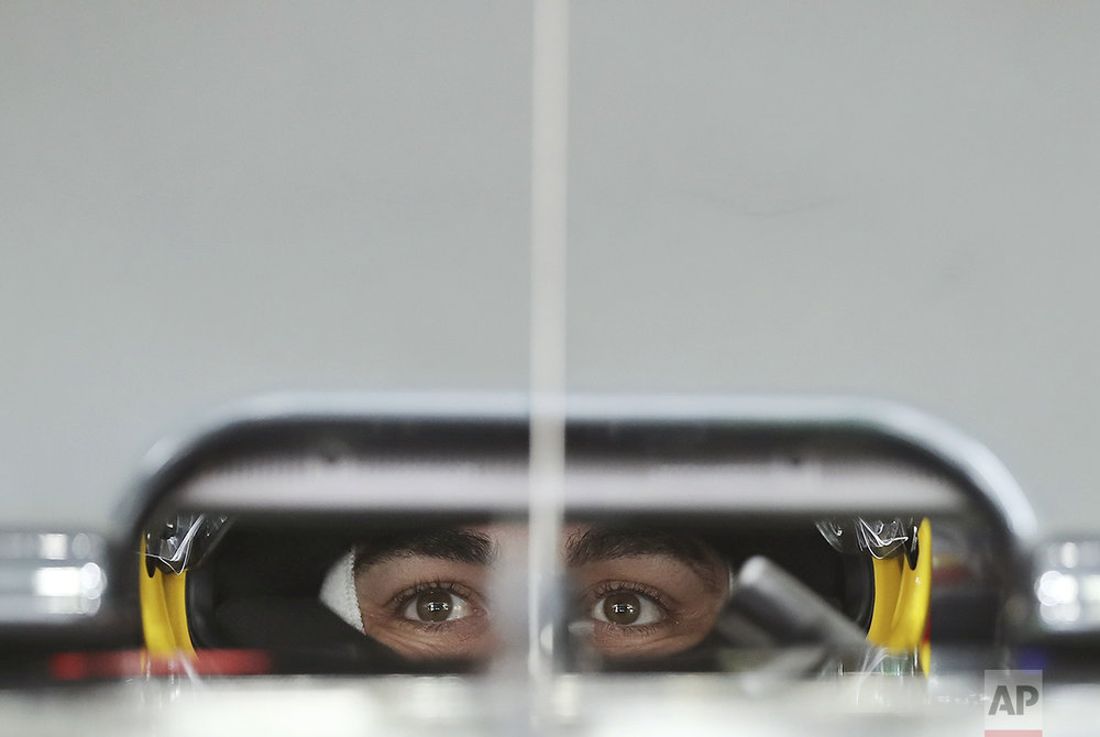 McLaren driver Fernando Alonso, of Spain, waits in his car at his garage during the third practice session for the Japanese Formula One Grand Prix at the Suzuka International Circuit in Suzuka, central Japan, Saturday, Oct. 8, 2016. (AP Photo/Eugene Hoshiko)