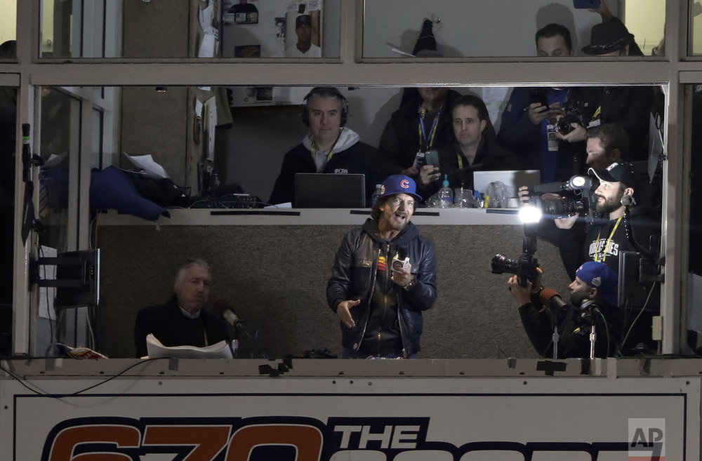 """Eddie Vedder sings """"Take Me Out to the Ballgame"""" during the seventh inning of Game 5 of the Major League Baseball World Series between the Cleveland Indians and the Chicago Cubs Sunday, Oct. 30, 2016, in Chicago. (AP Photo/Charlie Riedel)"""