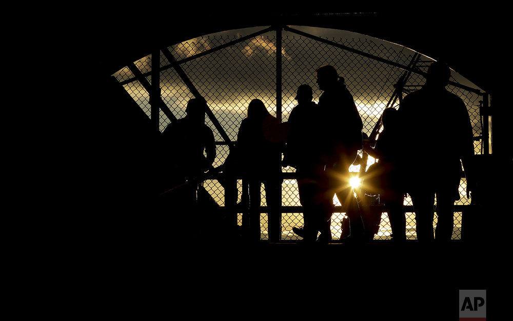 Fans walk to their seats before Game 5 of the Major League Baseball World Series between the Cleveland Indians and the Chicago Cubs, Sunday, Oct. 30, 2016, in Chicago. (AP Photo/Charlie Riedel)
