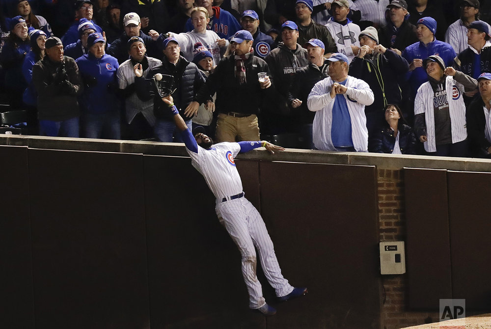 Chicago Cubs right fielder Jason Heyward catches a fly ball hit by Cleveland Indians' Trevor Bauer during the third inning of Game 5 of the Major League Baseball World Series Sunday, Oct. 30, 2016, in Chicago. (AP Photo/Charles Rex Arbogast)