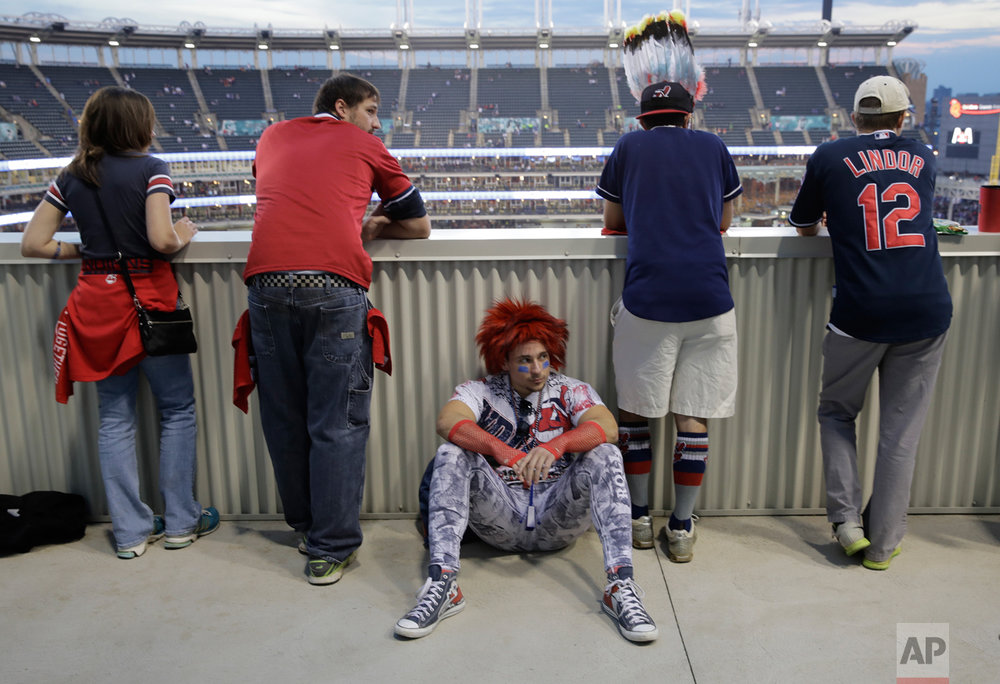 Cleveland Indian fans watch batting practice before Game 7 of the Major League Baseball World Series against the Chicago Cubs Wednesday, Nov. 2, 2016, in Cleveland. (AP Photo/Charlie Riedel)