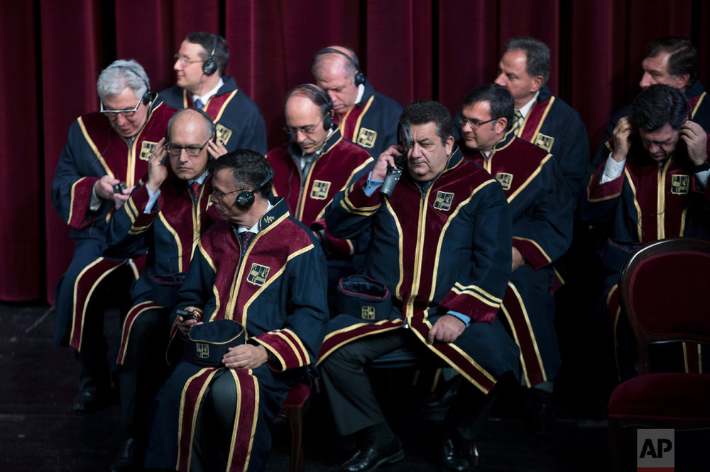 Professors of Piraeus University listens the speech of Russian Foreign Minister  Sergey Lavrov, at Piraeus Municipal Theater , near Athens, on Wednesday, Nov. 2, 2016. Lavrov  took part in  the ceremony by Piraeus University to receive an honorary doctorate. (AP Photo/Petros Giannakouris)