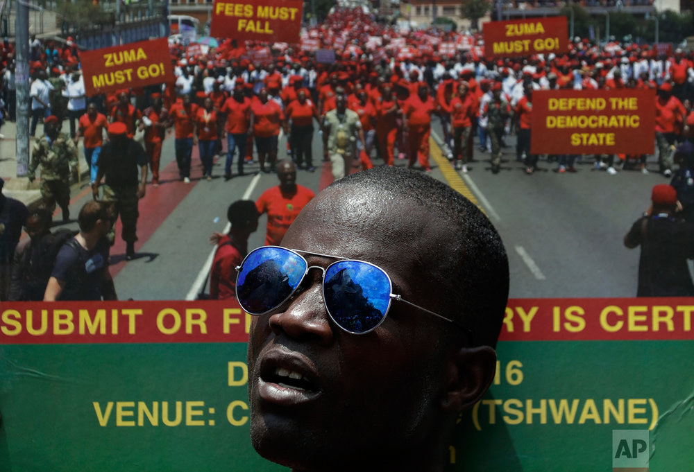 A member of the Economic Freedom Fighters (EFF) holds a placard during an anti-government march in Pretoria, South Africa, Wednesday, Nov. 2, 2016. Thousands of South Africans are demonstrating for the resignation of President Jacob Zuma, who has been enmeshed in scandals that critics say are undermining the country's democracy. (AP Photo/Themba Hadebe)