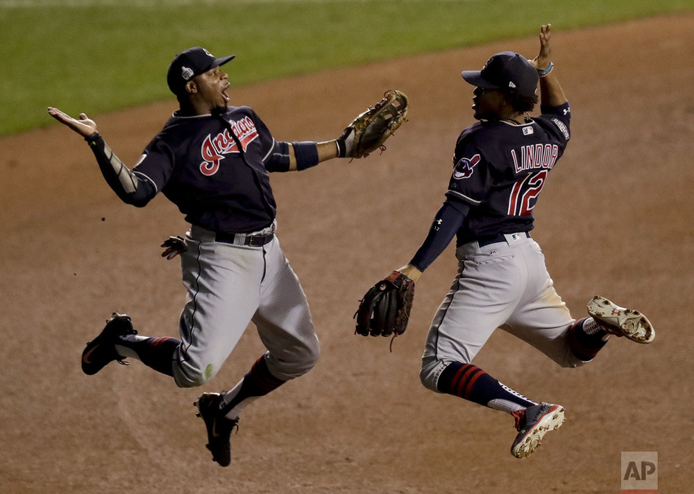 Cleveland Indians left fielder Rajai Davis, left, and shortstop Francisco Lindor celebrate their win after Game 4 of the Major League Baseball World Series against the Chicago Cubs, Saturday, Oct. 29, 2016, in Chicago. After seven games, the Cubs won their first World Series title in 108 years. (AP Photo/Charles Rex Arbogast)