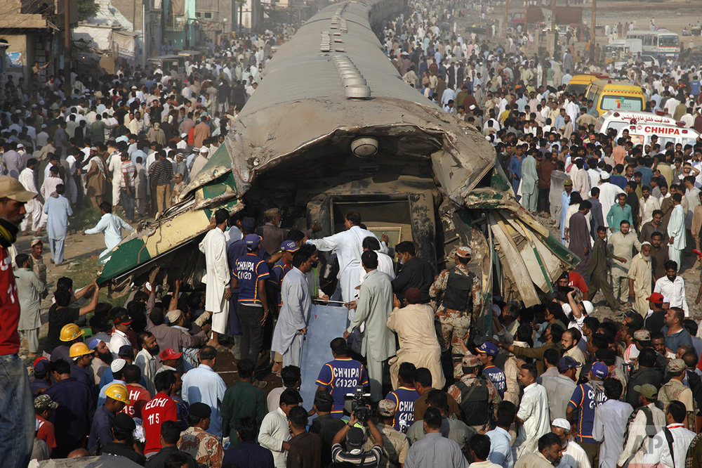 Volunteer rescuers work at the site of a train accident in Karachi, Pakistan, Thursday, Nov. 3, 2016. The passenger train crashed into the back of another in the southern port city Thursday, killing and injuring dozens. (AP Photo/Shakil Adil)