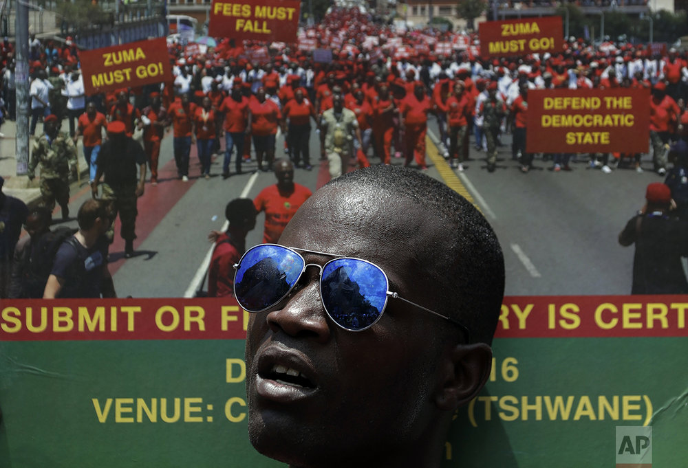 A member of the Economic Freedom Fighters (EFF) holds a placard during an anti-government march in Pretoria, South Africa, Wednesday, Nov. 2, 2016. Thousands are calling for the resignation of President Jacob Zuma, who has been enmeshed in scandals that critics say are undermining the country's democracy. (AP Photo/Themba Hadebe)