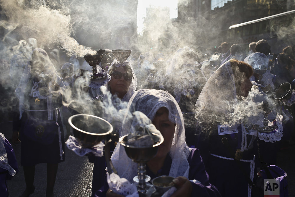 "Veiled women carry censers during a procession honoring The Lord of Miracles in the Plaza de Armas in Santiago, Chile, Saturday, Oct. 29, 2016. Peruvians in Chile gathered to take part in the religious procession to celebrate the ""Señor de los Milagros,"" the patron saint of most Catholic Peruvians. (AP Photo/Esteban Felix)"