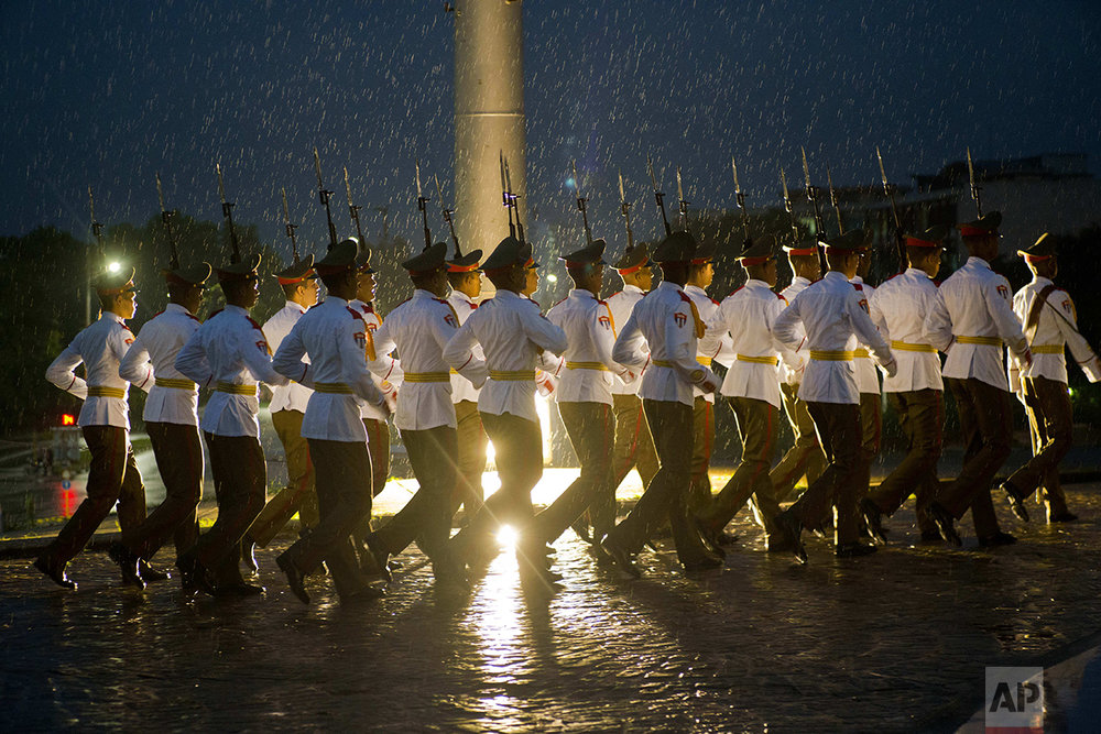 A Cuban honor guard marches through the rain after taking part in a ceremony for Canada's Prime Minister Justin Trudeau, at Revolution Square in Havana, Cuba, Tuesday, Nov. 15, 2016. (AP Photo/Ramon Espinosa)