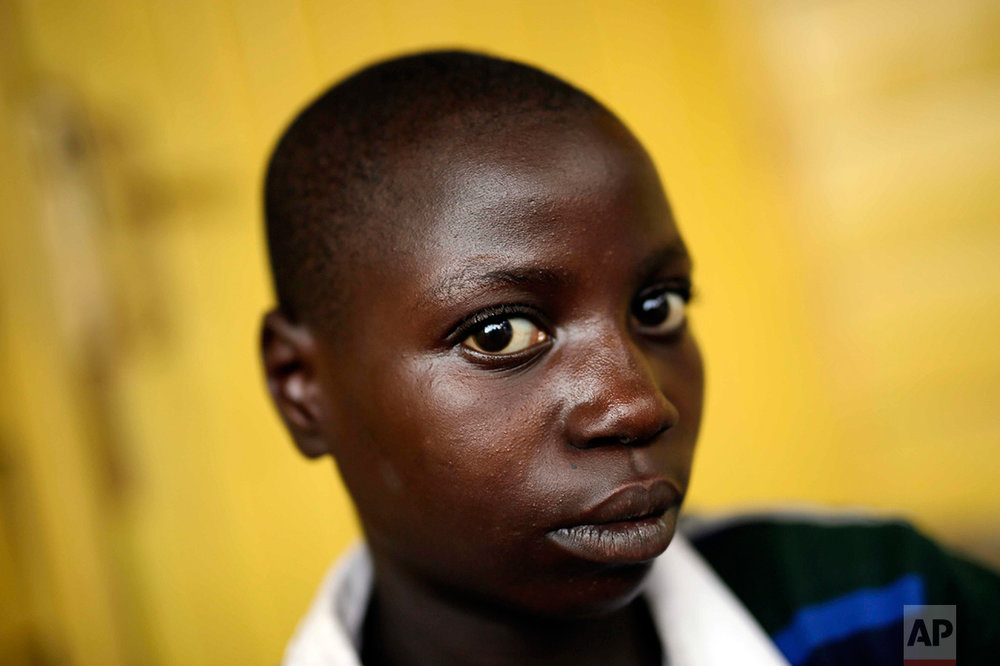 In this photo taken on Sunday, June 19, 2016, Anuarita Mahoro, 12, tells her story of rejection because she was among those ostracized due to physical problem after her parents died, at the En Avant Les Enfants INUKA center in Goma, Democratic Republic of Congo. She was also rejected because of her parents' pasts. (AP Photo/Jerome Delay)