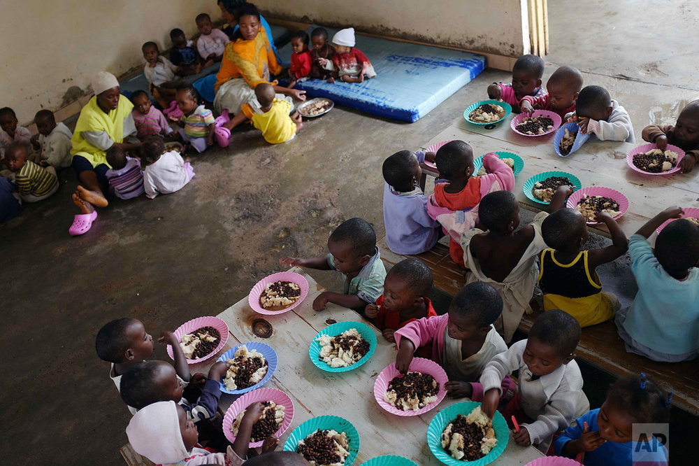 n this photo taken on Saturday, June 18, 2016, orphans eat their lunch at the Don Bosco center in Goma, Democratic Republic of Congo. (AP Photo/Jerome Delay)