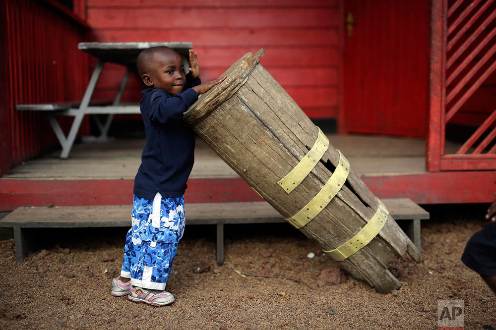 In this photo taken on Sunday, June 19, 2016, five-year-old Alpha Meleki plays in the yard at the En Avant Les Enfants INUKA center in Goma, Democratic Republic of Congo. (AP Photo/Jerome Delay)