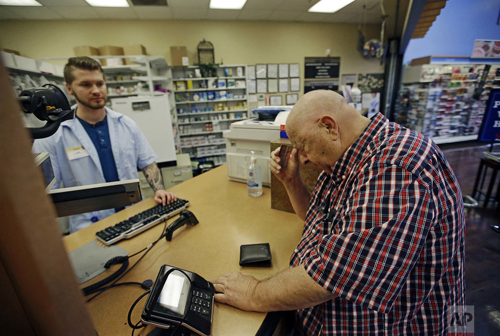 "Uber driver Russ Schmidt, 74, picks up his wife's prescription drugs from Smiths Pharmacy in Salt Lake City on Thursday, June 2, 2016. Schmidt, who retired 10 years earlier, said he became an Uber driver after his wife's fall 2015 hospitalization and uses the money to help pay for her medication. ""I'm a fanatical fan of this country. I think it's the best country in the world and always has been,"" he says. ""I think we're in real trouble right now. I have worked, and I still continue at 75 to work my butt off to make a good life for my family. And now that it is almost being stolen from me."" (AP Photo/Rick Bowmer)"
