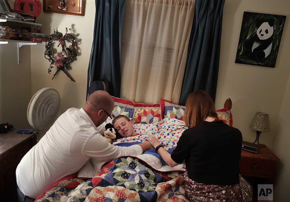 "Richie Clendenen, lead pastor at Christian Fellowship Church, left, and his wife Jenny, say evening prayers with their son, Trey, 11, as he goes to bed at their home in Benton, Ky., Sunday April 10, 2016. ""I worry about the country he's going to inherit. I feel our rights are slowly being taken away from us,"" said Richie Clendenen. ""I pray if Christianity could lose all rights in his future, I question what that's going to mean for him?"" Even in this deeply religious swath of western Kentucky - a state where about half the residents are evangelical - conservative Christians feel under siege. (AP Photo/David Goldman)"