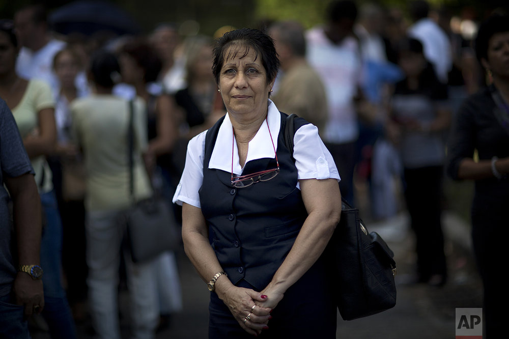 "Airport employee Margarita Montalvo poses for a photo as she waits in line to pay tribute to the late Fidel Castro near Revolution Plaza, in Havana, Cuba, Monday, Nov. 28, 2016. ""I am sad today. All my life, 59 years, I have been with the revolution. The imperialist enemy is not going to enter here, we are organized."" (AP Photo/Rodrigo Abd)"