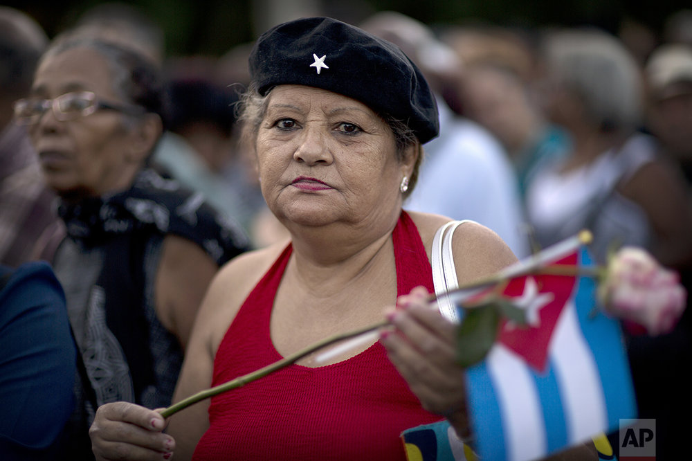 "Psychologist Gabriela Lopez, 67, poses for a photo as she waits in line to pay her respects to the late Fidel Castro near Revolution Plaza, in Havana, Cuba, Monday, Nov. 28, 2016. ""Today I feel the same as when I lost my father. We lost him (Fidel) physically, but he is still alive within us."" (AP Photo/Rodrigo Abd)"