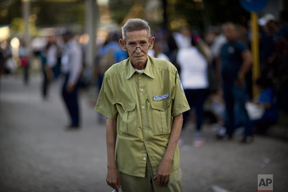 "Transport Department worker Jose Anaya, 66, poses for a photo as he waits in line to pay tribute to the late Fidel Castro near Revolution Plaza, in Havana, Cuba, Monday, Nov. 28, 2016. ""We were born with Fidel. This is a very hard moment for us."" (AP Photo/Rodrigo Abd)"