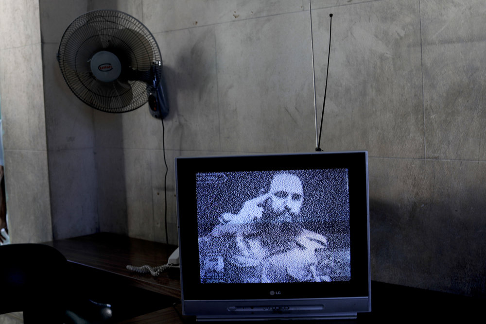 In this Nov. 29, 2016 photo, a television showing grainy black and white footage of Fidel Castro delivering a speech, sits on a table at a memorial in his honor in Guanabacoa, on the outskirts in Havana, Cuba. President Raul Castro said Cuba would bar statues of Castro and monuments bearing his name in keeping with the former leader's desire to prevent the growth of a cult of personality. (AP Photo/Natacha Pisarenko)