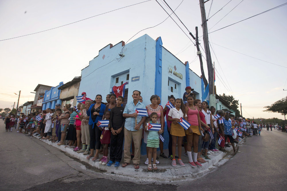 In this Nov. 30, 2016 photo, people wait for the arrival of the caravan carrying the ashes of Cuba's late leader Fidel Castro, during a funeral procession that retraces the path of Castro's triumphant march into Havana nearly six decades ago, in Esperanza, Cuba. Castro's ashes travelled in a a four-day journey across Cuba from Havana to their final resting place in the eastern city of Santiago. Castro died Nov. 25 at 90. (AP Photo/Ricardo Mazalan)