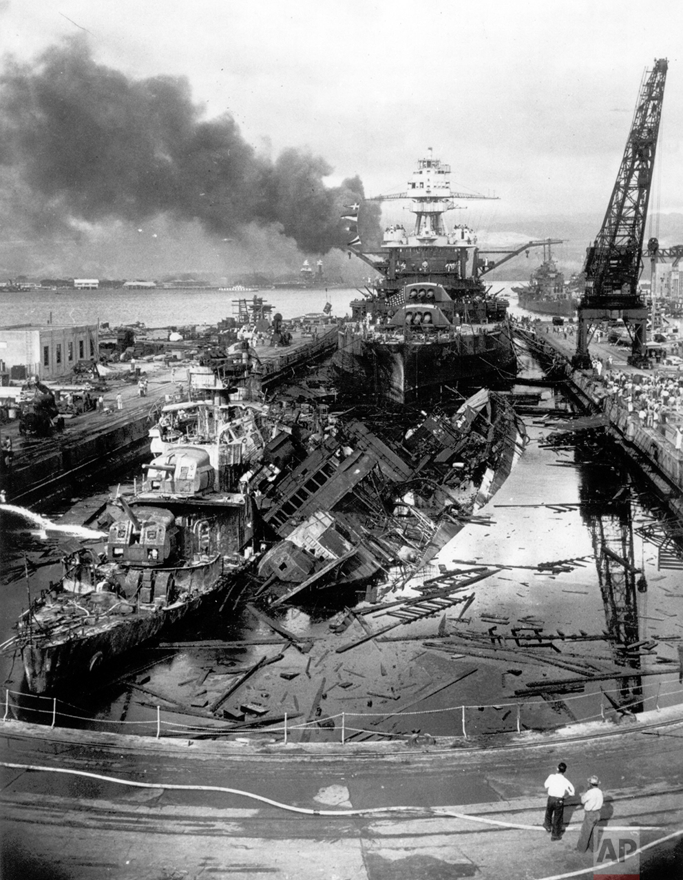 Black smoke rises from the burning wrecks of several  U.S. Navy battleships after they had been bombed during the Japanese surprise attack on Pearl Harbor, Hawaii, on December 7, 1941. (AP Photo)
