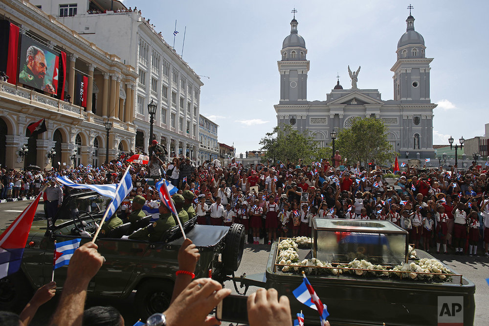 "People chant ""I am Fidel!"" as the motorcade carrying the ashes of the late Cuban leader Fidel Castro leaves Cespedes Park in Santiago, Cuba, on Dec. 3, 2016. After days of national mourning and a tour of his ashes through the countryside, his remains have arrived at the city where they will be laid to rest. (AP Photo/Dario Lopez-Mills)"