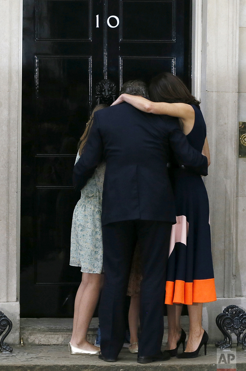 Britain's Prime Minister David Cameron, his wife Samantha and their children Nancy, Elwen and Florence, hug on the steps of 10 Downing Street in London on July 13, 2016. Cameron stepped down after six years as prime minister. (AP Photo/Kirsty Wigglesworth)