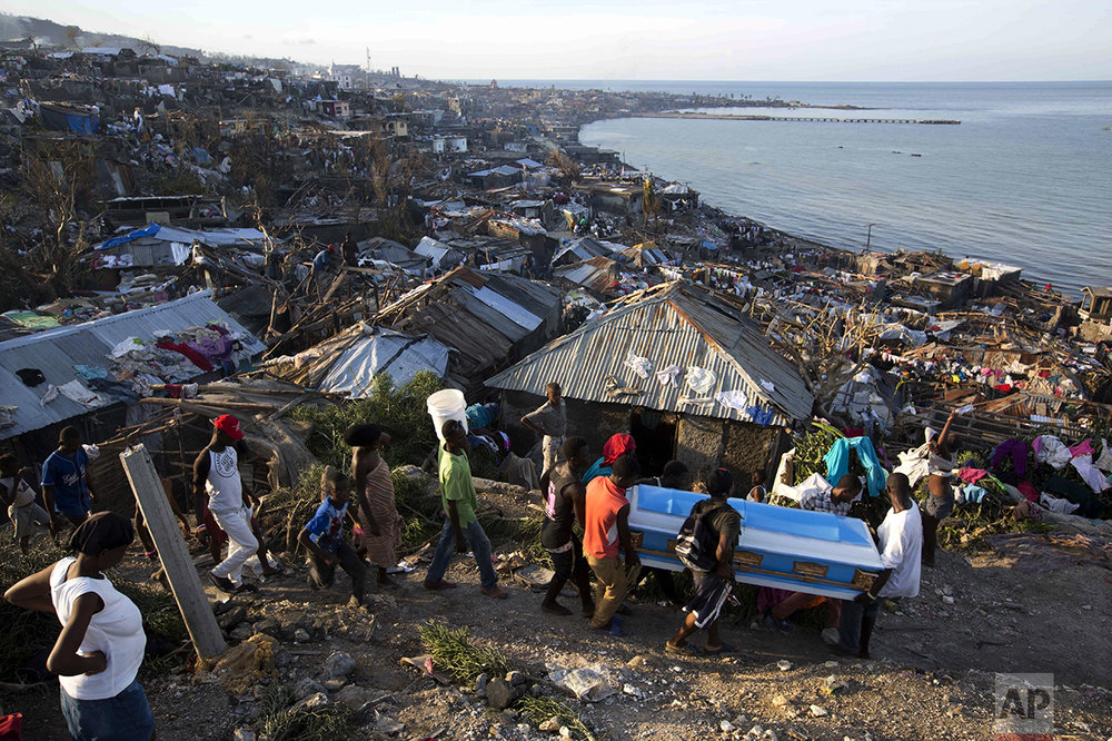 Residents carry a coffin containing the remains of a pregnant woman, a victim of Hurricane Matthew, in Jeremie, Haiti, on Oct. 7, 2016. (AP Photo/Dieu Nalio Chery)