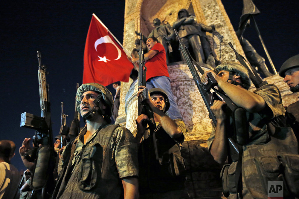 Turkish soldiers secure the area as supporters of Turkey's President Recep Tayyip Erdogan protest in Istanbul's Taksim square on July 16, 2016. Prime Minister Binali Yildirim said a group within Turkey's military had engaged in what appeared to be an attempted coup. (AP Photo/Emrah Gurel)