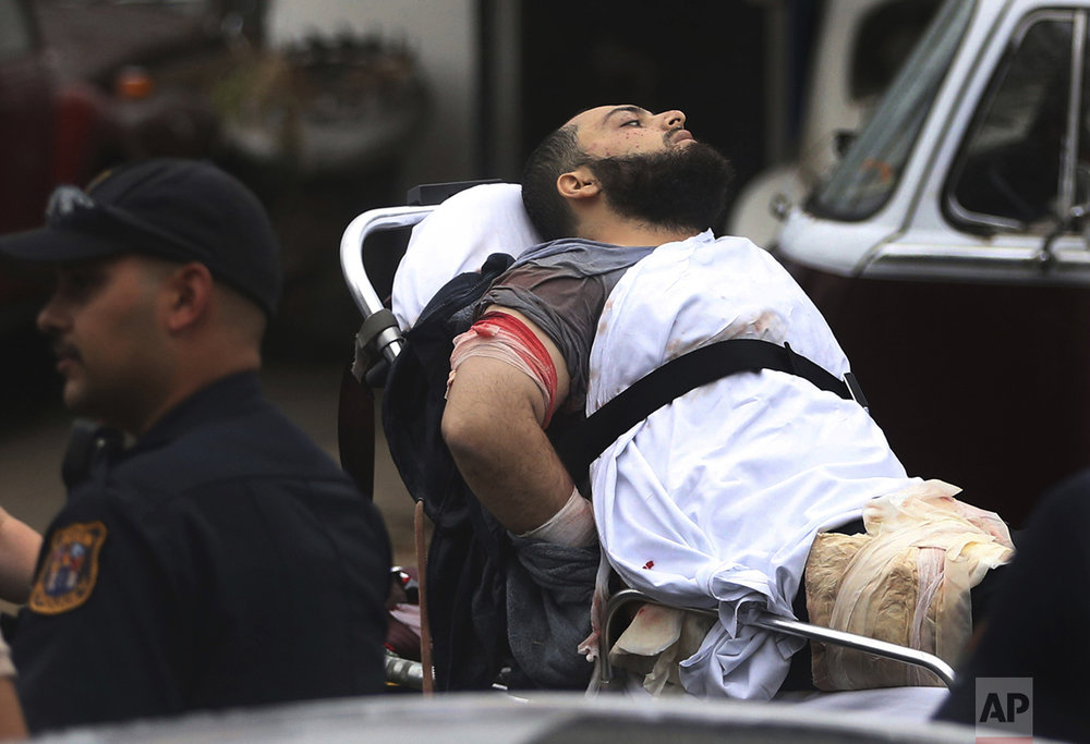 Ahmad Khan Rahami is taken into custody after a shootout with police on Sept. 19, 2016, in Linden, N.J. Rahami was wanted for questioning in the bombings that rocked the Chelsea neighborhood of New York and the New Jersey shore town of Seaside Park. (Ed Murray/NJ Advance Media via AP)