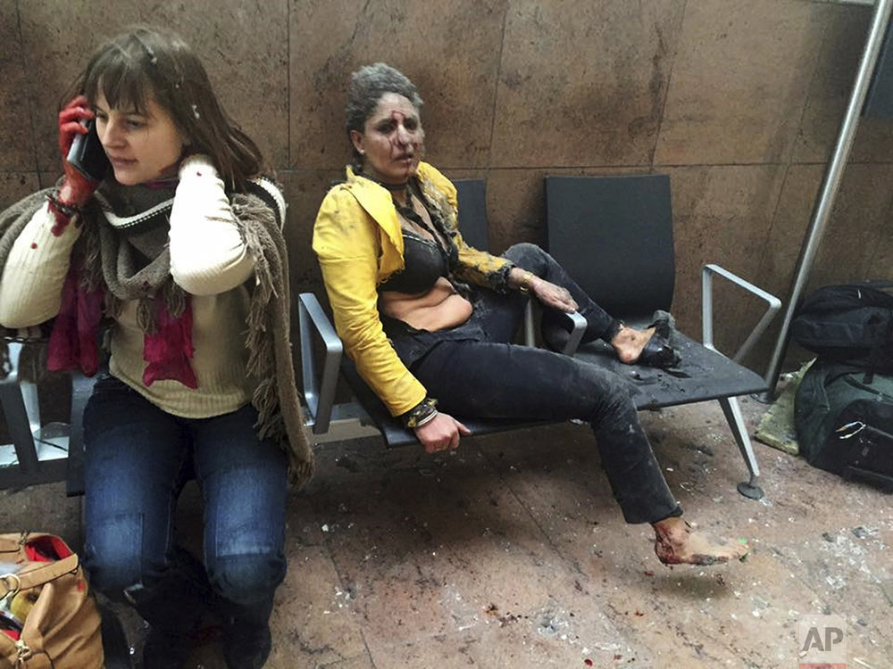 In this photo provided by Georgian Public Broadcaster and photographed by Ketevan Kardava, Nidhi Chaphekar, a 40-year-old Jet Airways flight attendant from Mumbai, right, and another unidentified woman are shown after being wounded in Brussels Airport in Brussels, Belgium, after explosions rocked the airport on March 22, 2016. (Ketevan Kardava/Georgian Public Broadcaster via AP)