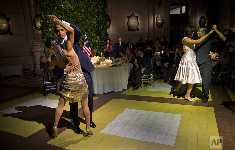 President Barack Obama and first lady Michelle Obama, right, dance the tango with tango dancers during the State Dinner at the Centro Cultural Kirchner in Buenos Aires, Argentina, on March 23, 2016. (AP Photo/Pablo Martinez Monsivais)