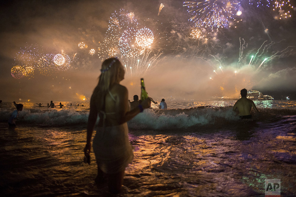 Fireworks light the sky over Copacabana beach during New Year's Eve celebrations in Rio de Janeiro, Brazil, on Jan. 1, 2016. (AP Photo/Mauro Pimentel)