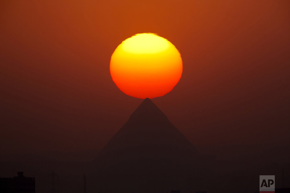 The sun sets over the the Giza Pyramids near Cairo, Egypt, on Aug. 19, 2016. (AP Photo/Amr Nabil)