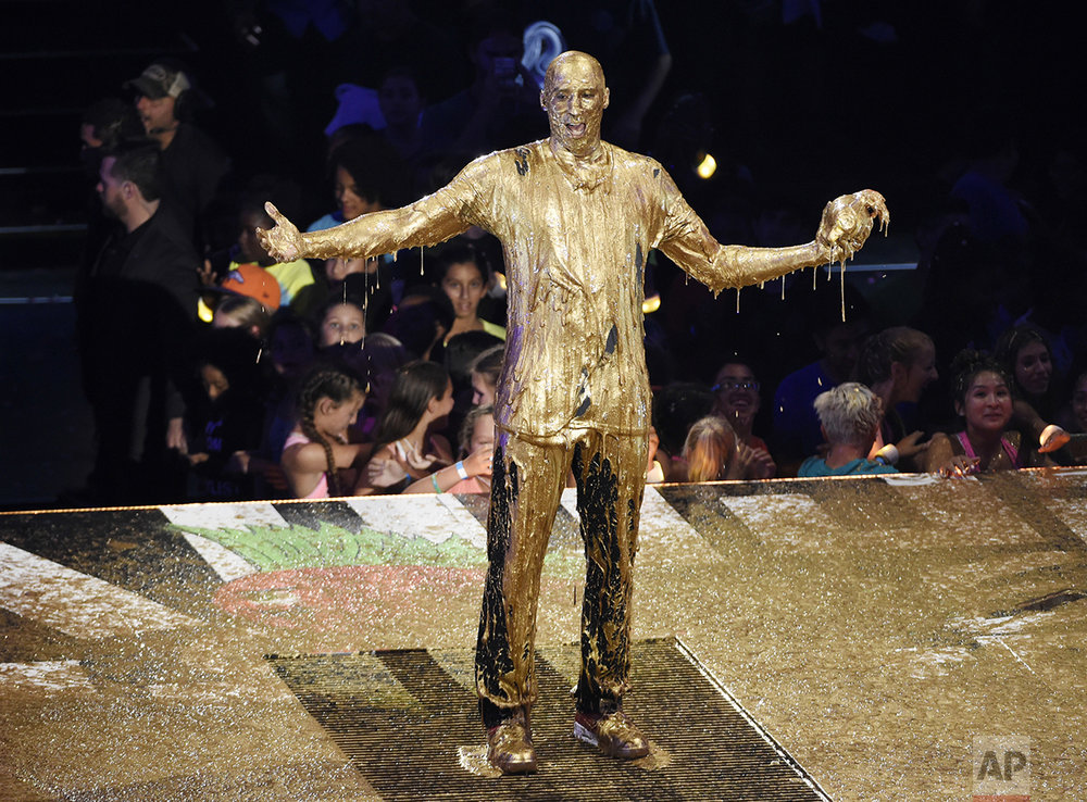 "Retired NBA basketball player and Legend Award recipient Kobe Bryant poses after being ""slimed"" onstage during the 2016 Kids' Choice Sports Awards at Pauley Pavilion on July 14, 2016, in Los Angeles. (Photo by Chris Pizzello/Invision/AP)"