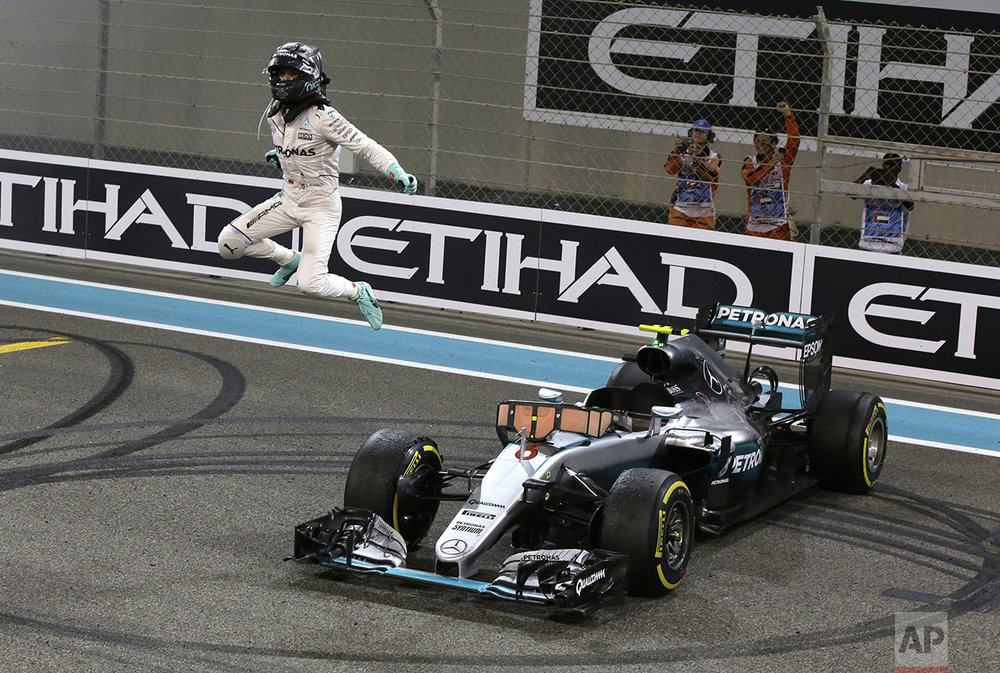 Mercedes driver Nico Rosberg of Germany celebrates after finishing second to win the 2016 world championship during the Emirates Formula One Grand Prix at the Yas Marina racetrack in Abu Dhabi, United Arab Emirates, on Nov. 27, 2016. (AP Photo/Luca Bruno)